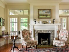 FRENCH DOORS WITH TRANSOMS ABOVE ON EITHER SIDE OF FIREPLACE IN LIVING ROOM....COULD DO THEM LIKE THIS OR PUT SOLID PIECE WITH SOME KINE OF STAINED GLASS OR LEADED GLASS?????