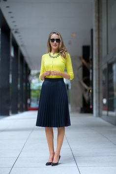 Love the pleated skirt and closed up cardigan. Perfect feminine look for work.