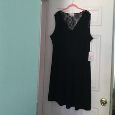 Beautiful little black dress. Gorgeous! Ladylike, and sexy LBD. V-neck crossover neckline, band under the bust area, with soft gathers. The upper back area in back is a pretty black lace design. 95% polyester, 5% spandex. Never worn. Fleur by David Rodriguez Dresses Midi