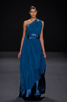 One-shoulder sapphire blue chiffon gown with satin waist and angled borders. Gathered front and cape-style back. Naeem Khan Fall 2013
