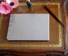 Hand bound grey A5 blank notebook, journal, sketchbook, Coptic stitch, rainbow thread by TheCraftFantastic on Etsy