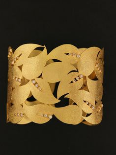 Cuff | London Jewelers Designs. 18KT Yellow Gold and Diamonds