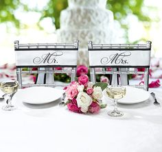 I love the thought of having specially decorated chairs for the newly wedded couple :)