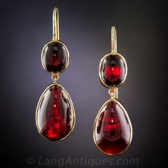 Antique Garnet Drop Earrings. Glowing cabochon garnet drops swing-and-sway, to-and-fro and back-and-forth from matching ovals in these delightful, late 19th~early 20th century Bohemian (Czechoslovakian) ear drops crafted in 14K yellow gold.