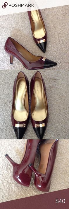 Coach Two tone pump Gorgeous burgandy pump with black color block toe and Coach logo plate. No signs of wear to shoe or inner sole. Slight scuffing on bottom. Size 7 1/2 Coach Shoes Heels