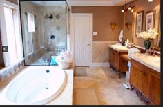 The master bath has a separate extra large tub and shower, NEW his and hers vanities with plenty of storage space.