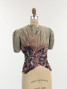 Blouse, Evening.  Elsa Schiaparelli (Italian, 1890–1973).  Date: winter 1938–39. Culture: French. Medium: silk, metal. Dimensions: Length at CB: 23 in. (58.4 cm).