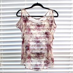 Floral tank Delias. Size XS but fits like a S/M! See through. Cute to wear with bandeau. Tops Tank Tops