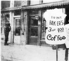 Red Bluff grocier standing in front of grocery store advertising Baker's coffee 3 for $1. Also wearing an apron that says Maxwell House Coffee :: Northeastern California Historical Photograph Collection