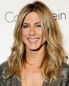 """Dirty Blond with Light Blond Streaks  Jennifer Aniston's colorist Michael Canale describes her shade as """"a caramelized blond with three signature highlights in sandy—almost beige—tones, to bring out her eye color."""" To time touch ups for this look, Canale advises, """"try and set a regimen—every four weeks, six weeks, up to three months—and when you find it, stick with it."""""""