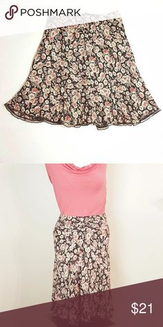 "Nine West Floral Skirt Nine West Floral Skirt. Side zipper. Colors: pink, beige, and brown. Size 4. 100% rayon. Measurements: 28"" waist, 23"" length. Nine West Skirts A-Line or Full"