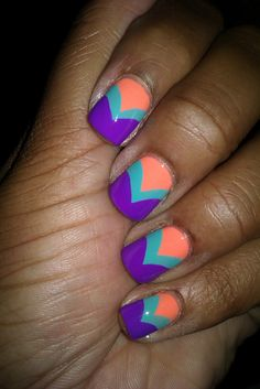 chevron nails -- I think I like the colors... And this chevron is a little more acceptable to me than others.