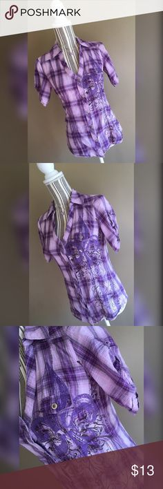 "🎄BUY 2, GET 1 FREE!🎄 Purple plaid short-sleeved button shirt with fleur-de-lis design by Vanity. Size Medium. Bust 34"" lying flat, stretches to 36"". Shoulder to hem length 24.5"".🎄BUY 2, GET 1 FREE!🎄 Buy any 2 items and get a third item under $12 for FREE! The item of least value will be used as the free item. Add all 3 items to a bundle and make me an offer for the total of the 2 higher priced items only! Vanity Tops Button Down Shirts"