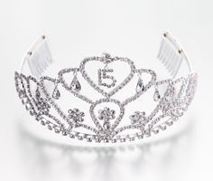 This beautiful tiara is silver-plated and decorated with clear crystals that glitter with the light. Six teardrop crystals dangle from the front of the tiara - three on the left and three on the right