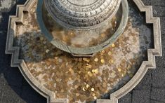 Students may toss coins into the fountain in hopes of promoting a better grade on their tests.   The fountain becomes clogged around exam season.