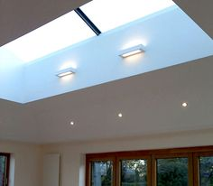 1 No Bespoke Fixed Ridgeglaze Rooflight x (return x (return on a 20 degree pitch, each return split into 2 equal sections with aluminium back to back angles at the join. Glass Roof, Glass Ceiling, Glass Extension, Roof Light, House Extensions, Loft Spaces, Living Room Lighting, Lighting Solutions, Light Fittings
