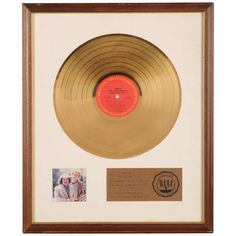 "Gold disc to Art Garfunkel for the album "" Simon and Garfunkels Greatest hits"" 
