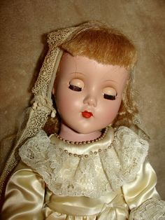 She is in very good condition and dressed in a First Holy Communion outfit. The outfit appears to not be handmade but there are no labels in the outfit. Off white, the satin dress is in very good condition, as is the underwear. | eBay!