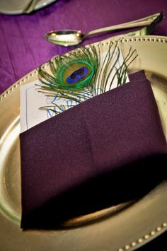 Real Wedding: Tiffany & Woodrow.  Peacock themed place setting.