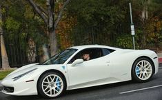 Justin-Bieber in his White Ferrari 458 Italia. Hit the image to see his 'Leopard print' Audi R8. It will make you sick!