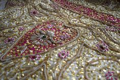 Hand embroidery on an antique Indian skirt.