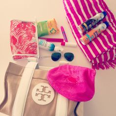 Bathing suit, deodorant, sunscreen, cover up, flip flops, & beach bag.