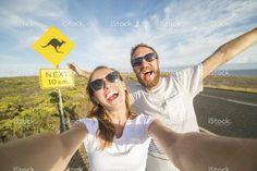 Young couple take selfie portrait near kangaroo warning sign-Australia stock photo 87550373 - iStock