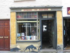 """""""Murder & Mayhem Bookshop, Hay-on-Wye, Wales,"""" by bluebeart, via Flickr -- Love the street-level art! Also, check out the clever """"book"""" bookstore sign here (http://www.pinterest.com/pin/175218241727779365/) and the floor art here (https://www.flickr.com/photos/graffitibadges/4973893770). Looks like a fun place!"""