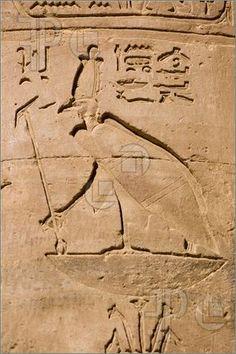 Photo of Ancient Egyptian hieroglyphic carving of the vulture goddess Nekhbet.  Pillar of the Temple of Horus, Edfu, Egypt.