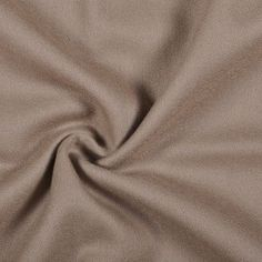 This is a medium weight, soft-handed, wool crepe in khaki. Drapes well, great for casual or formal apparel.