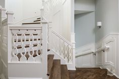 Stairs, white and wood, detailed carved cutout spindles via House of Turquoise: Stonecroft Homes