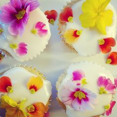 spring edible flowers on lemon curd filled cupcakes - create a tower of cupcakes instead of a traditional cake for your wedding