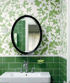 Emerald bathroom with green subway tiles in the bathroom with Florence Broadhurst wall paper