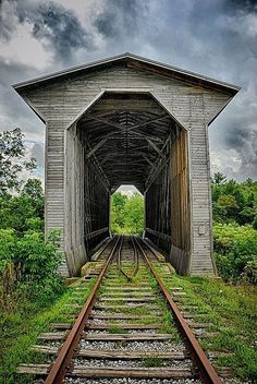 Fisher Railroad Bridge - near Wolcott, Vermont; covered railroad bridge built in crossing the Lamoille River; photo by masinka My favorite covered bridge! Railroad Bridge, Railroad Tracks, By Train, Train Tracks, Vermont, Old Bridges, Old Trains, Green River, Covered Bridges