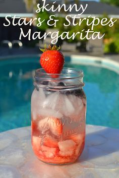 fourth of july festive cocktail: tequila, muddled strawberries, and frozen blueberries!  Perfect cocktail for a pool party or BBQ!