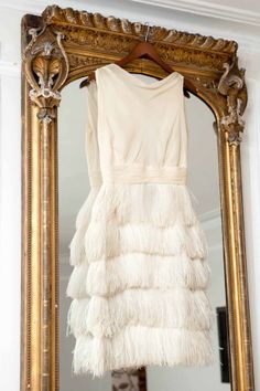 I've actually only worn [this dress] once to a ball in London. It's one of those make-friends dresses because people will come and talk about your dress. The mirror is antique; I got it in a junk shop in Long Island.——Annabel Tollman R.I.P