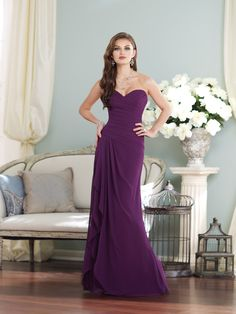 Strapless chiffon slim A-line gown with sweetheart neckline, asymmetrically ruched bodice with asymmetrically dropped waistline and corset back, side draped skirt features cascading ruffle. Removable straps included. Available in all chiffon colors. Color shown: Grape Sizes: 0 – 28