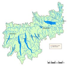 Oswego River/Finger Lakes Watershed Map.  Its headwaters originate in the southwestern Adirondack Mountains in the east and along the northern edge of the Appalachian Plateau and flow across the central lowlands before emptying into Lake Ontario.  Source: NYSDEC New York State Department of Environmental Conservation.  Larger map: http://www.dec.ny.gov/lands/48023.html#