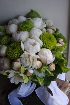 A white bouquet with pops of green