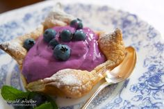 Blueberry Soy Yogurt in Puff Pastry Cups 4 sheets puff pastry, thawed 1 pint blueberries 2 Tbs. sugar 1/4 cup water 1 tsp. cornstarch 2-3 cups plain soy yogurt 1 Tbs. powdered sugar splash lemon juice generous pinch cinnamon