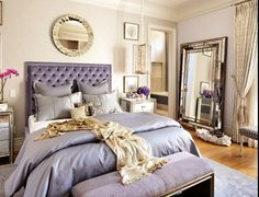 Tufted headboard.  Mirror. Bedroom.