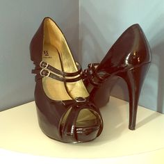 Bakers Patent Leather Peep Toe Pump Patent leather. A cleaner will get out the small scuffs... Hard to see unless up close. Two cross buckles and adorable buckle on the peep toe. These are cute and not too high. Comfortable too! Bakers Shoes Heels