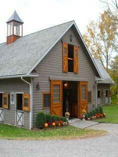 Horse Barn Stables Grey with Stained wood doors and windows and trim and cupola Autumn Colors