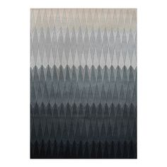 With its modern angular pattern, the Acacia by Linie Design is the perfect blend of contemporary Scandinavian style and traditional Nordic craft. Hand tufted using pure wool, this soft and spongy rug features textured geometric diamonds with a gradient of colour, floating from dark tones to light beige, woven into its design.