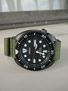"""Seiko """"Ninja"""" Turtle on green Nato Best Watches For Men, Amazing Watches, Cool Watches, Wrist Watches, Seiko Mod, Seiko Solar, Seiko Diver, Watches Photography, Nato Strap"""