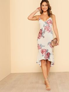 393896fcaa SheIn offers Flower Print Ruffle Dip Hem Cami Dress & more to fit your  fashionable needs.