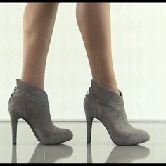 Jessica Simpson Bootie Suede ankle bootie with a hidden platform that has a chic back slit detail.  Never worn. Jessica Simpson Shoes Ankle Boots & Booties