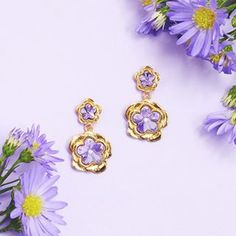 🌿 🌸The New Botanical Story 🌸🌿 Our delicately beautiful Botanical story returns in gold & with the signature violet crystals. These NEW double drop earrings are perfect for Summer parties! Still Life Photography, Fashion Photography, Summer Parties, Lilac, Florals, Swarovski Crystals, Jewelry Design, Rose Gold, Drop Earrings