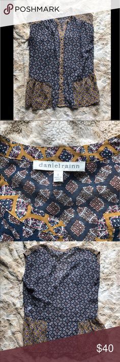 Daniel Rainn Blouse Daniel Rainn size 4 top. Paisley and mustard yellow with bronze buttons. Worn only twice, as new condition. Sleeveless style. Price is firm Daniel Rainn Tops