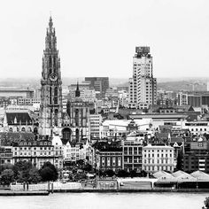 View on Antwerp, Belgium, cathedral and Art Deco KBC Tower (KBC is a Belgian bank), Europe's first skyscraper
